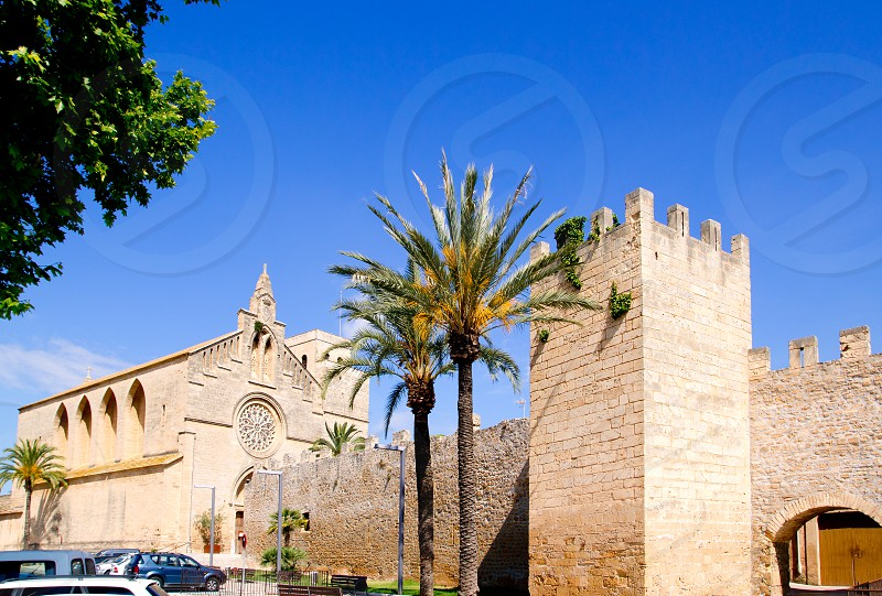 Alcudia Sant Jaume church near roman castle wall Mallorca island in Balearic Spain photo