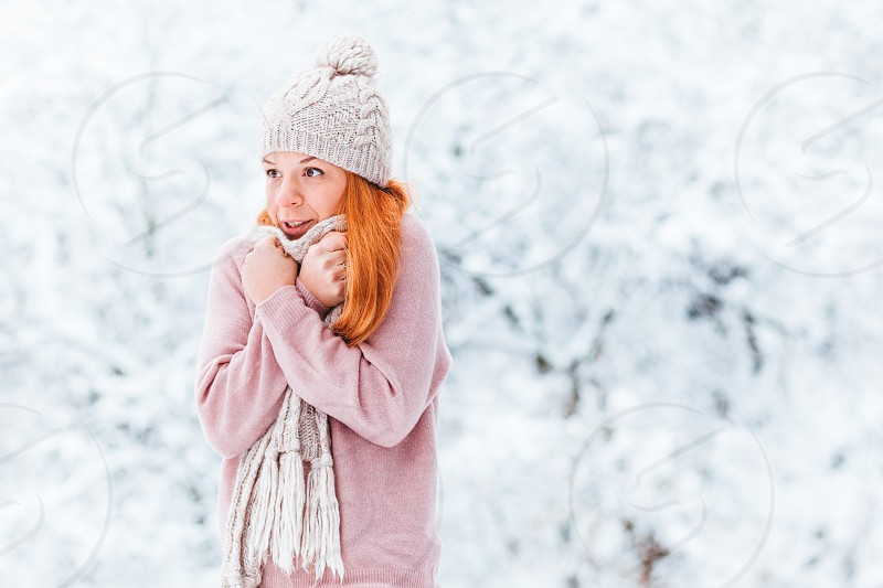 Portrait of a young woman in a snowy winter day photo