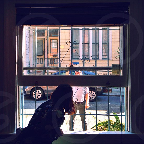 person looking out the window photo