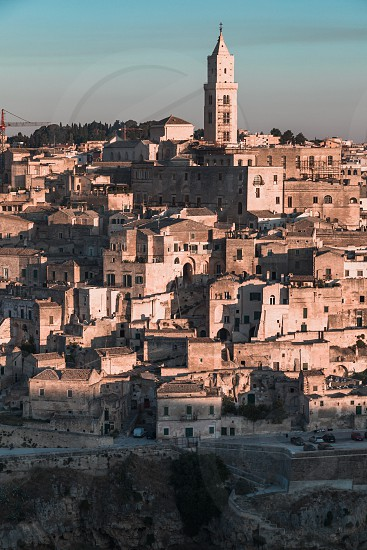 Matera Italy - August 2019: View of the ancient city of Matera from the Belvedere of Murgia Timone at the dawn of a day in August photo