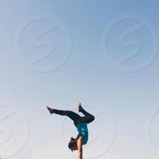 woman in blue shirt doing an  upside down photo