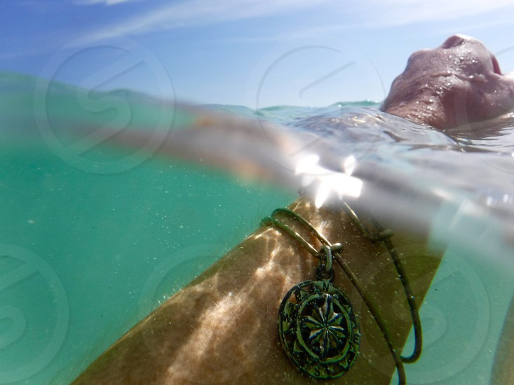 Freeport Bahamas Bahamas island ocean water swim fun summer fun sunny day sun compass bracelet arm reaching floating waves beach destination travel adventure photo