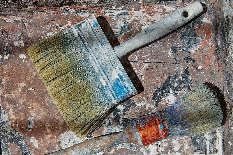 Paint brushes used on grunge bucket in improvement background photo