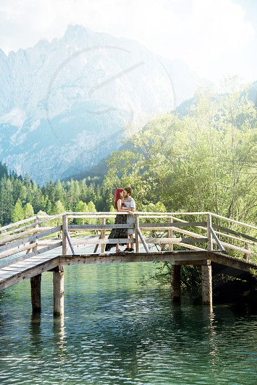 Happy young couple in love with romantic nature background. photo