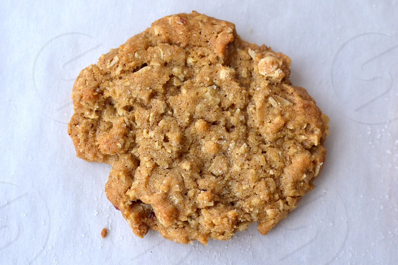 Oatmeal cookie on parchment paper with sugar dusting photo
