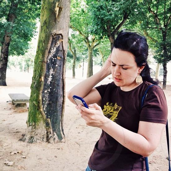 Iphoneographer portrait examining pics selfie photo