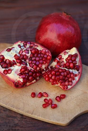 Pomegranates on Cutting Board photo