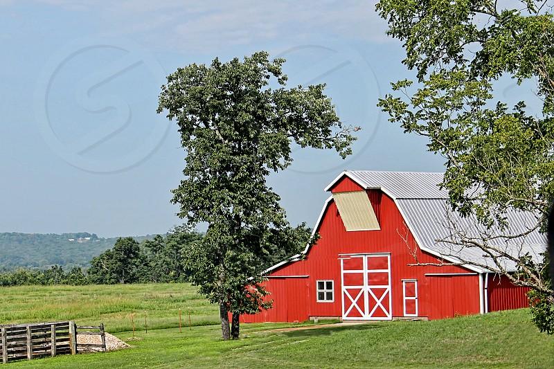 Bright red barn in a farm landscape photo