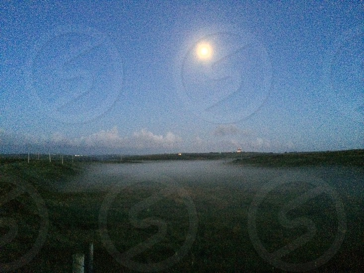 Bright moon with low lying fog photo