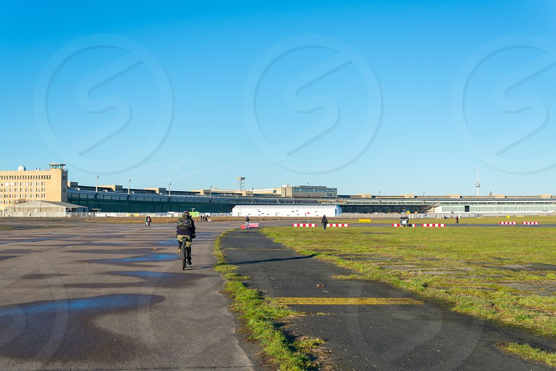 People exercise and relax during sunshine day at Tempelhof Airport park in Tempelhof Berlin photo