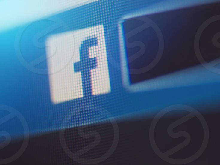 Facebook Icon on Computer Screen with Blue Glow Macro Closeup photo