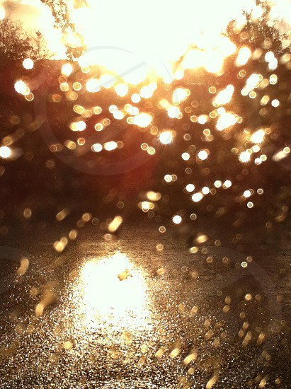 water drops in clear glass with sunrise view photo
