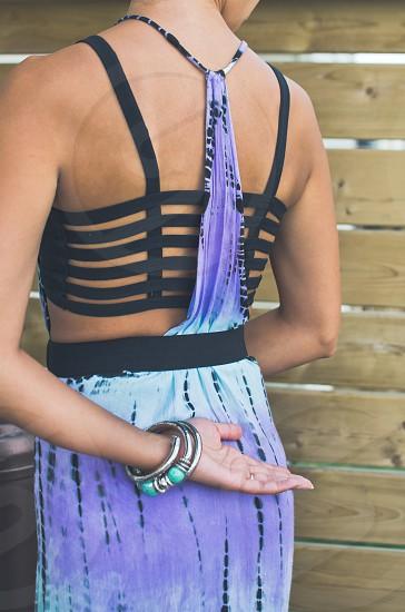 Back detail of a purple tie-dye summer dress. photo