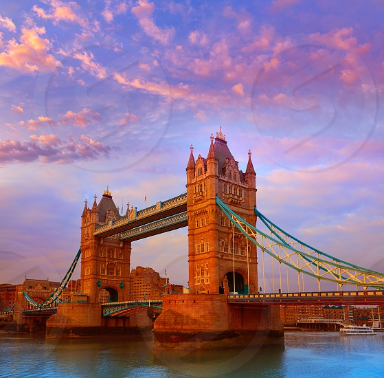 London Tower Bridge over Thames river sunset in England photo