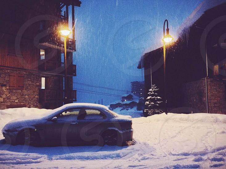 grey two door sedan in the snow photo