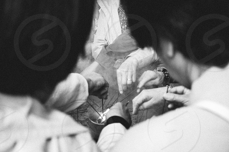Taken in Japan.  japan people pray hand incense frame culture bless worship prayer photo
