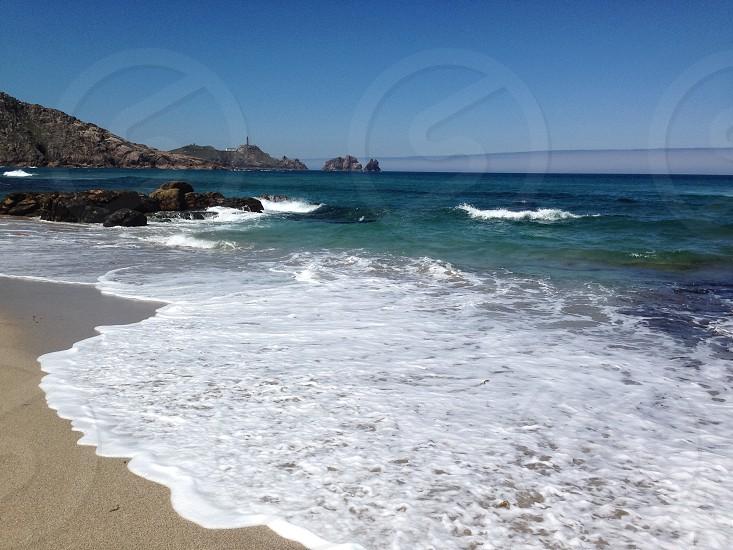 Spiaggia mare beach sea lighthouse photo