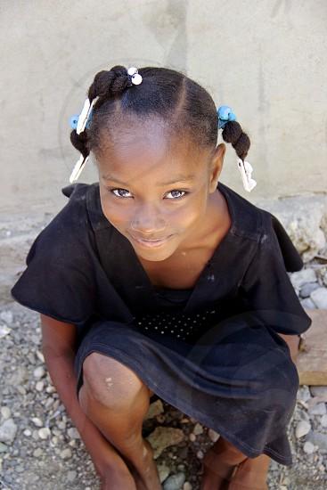 Haiti child girl eyes portrait people travel innocence photo
