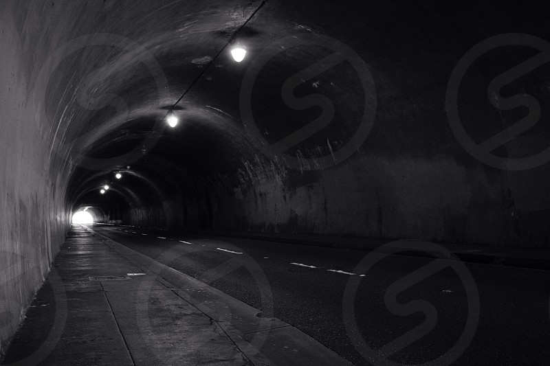 gray concrete tunnel photo