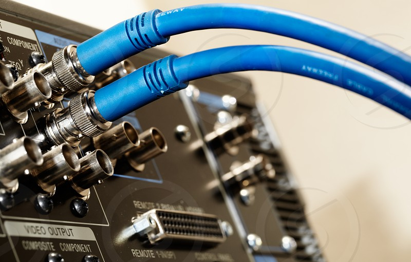 Macro shot of the 2 HD SDI-video cables and digital video connectors on the back of the professional vcr photo