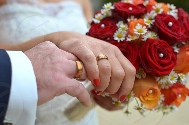 Wedding couple holding hands weddings photo