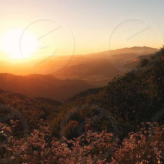view of a mountain range at sunset photo