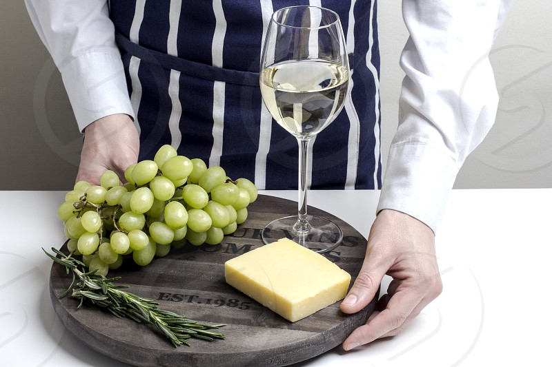 wine; cheese; food; board; grapes; fruit; human; element;  photo