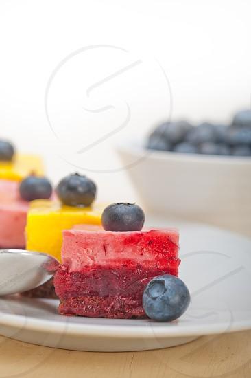 fresh strawberry and mango mousse dessert cake with blueberry photo