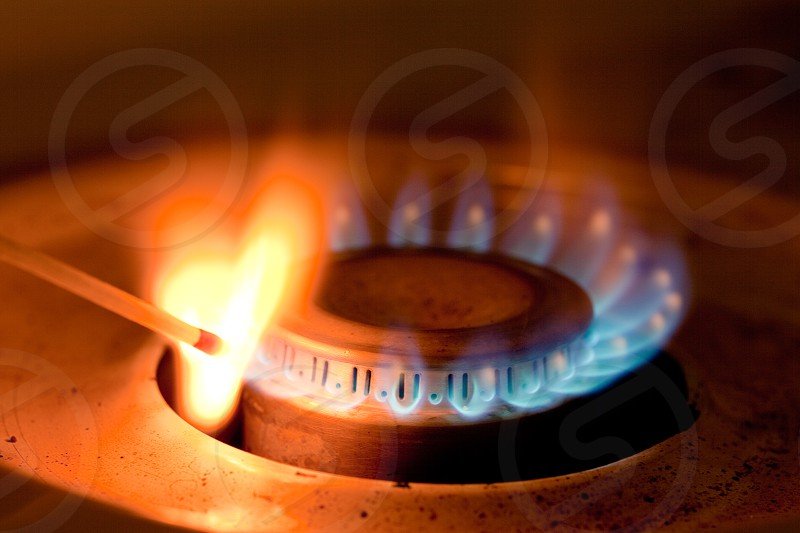 Blue flames of propane or natural gas burner ignite match photo