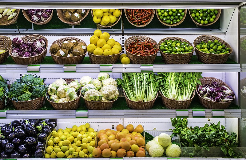 Fruits and vegetables on a supermarket shelf. photo