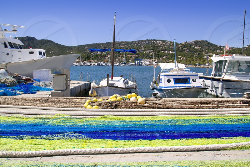 Fishing nets and tackle in Andratx port from mallorca Balearic island photo