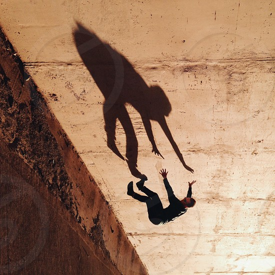 man leaping on wall photo