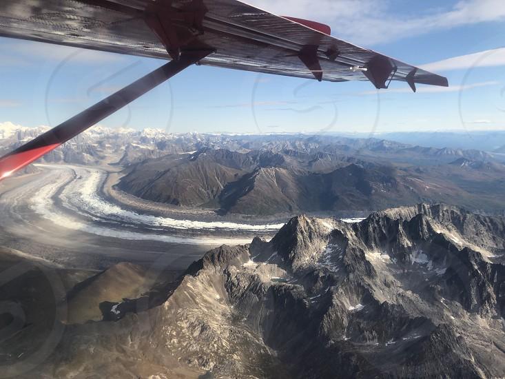 Flight mountains glacier wing Alaska Denali range peaks adventure  photo