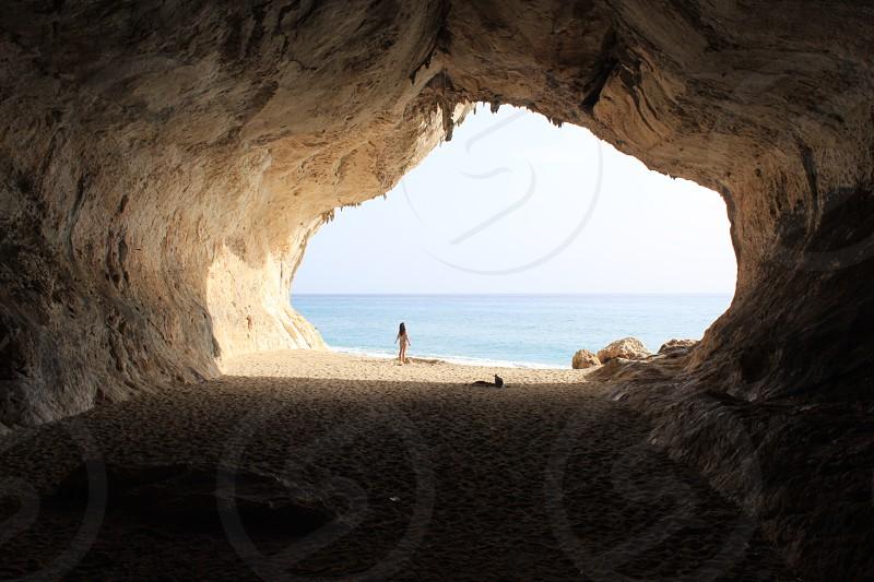 italy cave adventure female lifestyle travel wanderlust ocean water enjoy life live love photo