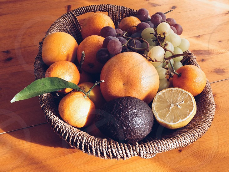 assorted fruits on brown wicker tray photo