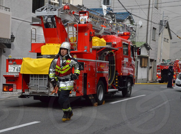 view of a firetruck and a fire fighter photo
