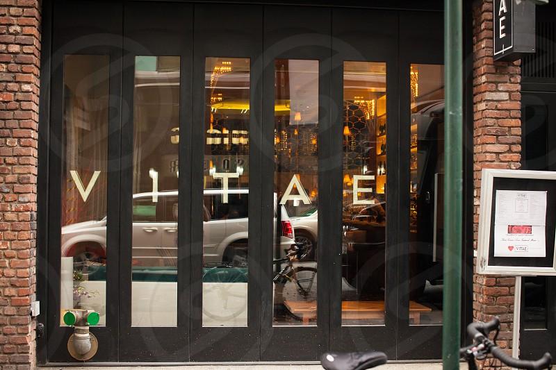 viyae printed in black wooden framed glass door photo