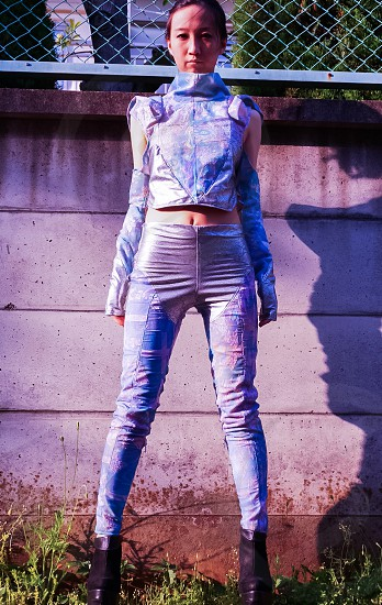 woman wearing blue cold-shoulder long-sleeved crop-top with blue leather jeans and black boots photo
