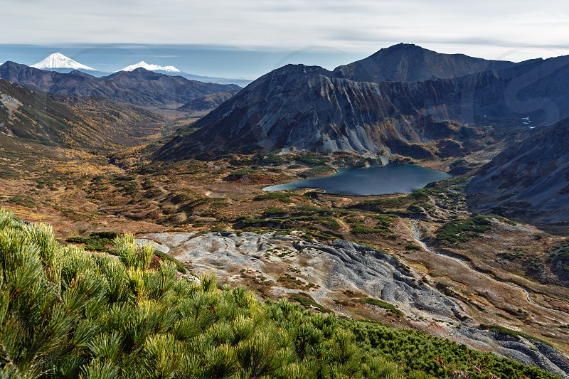 Beautiful autumn mountain landscape: picturesque view of mountains lake and volcanoes. Far East Russia Kamchatka Peninsula. photo
