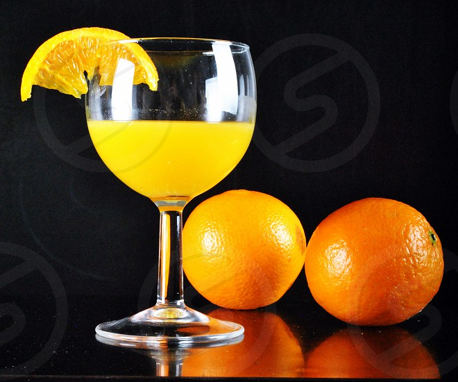 natural orange juice drink in wine glass photo