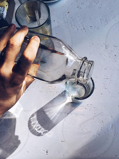 clear glass container near drinking glass photo