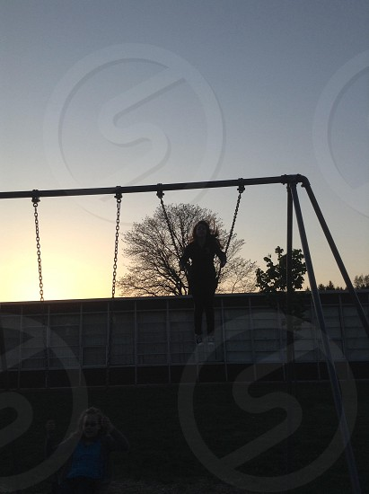 Swinging with the sun photo