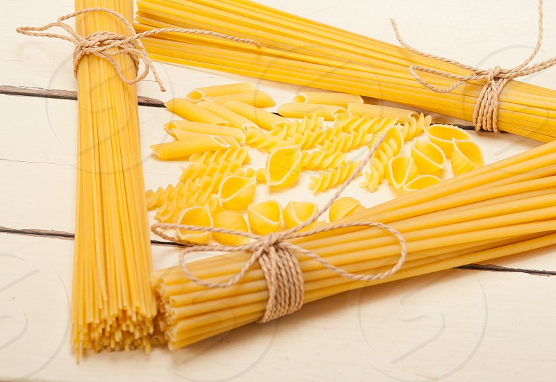 bunch of Italian pasta type on a white rustic table  photo