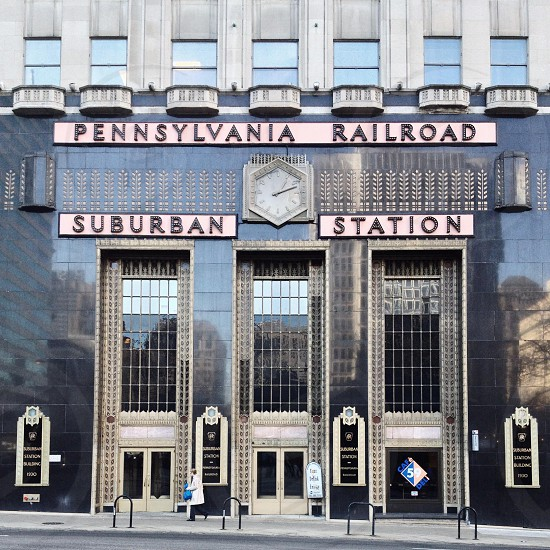 The beautiful art deco facade of Suburban Station Center City Philadelphia PA.  architecture art deco black pink marble station train city urban. photo