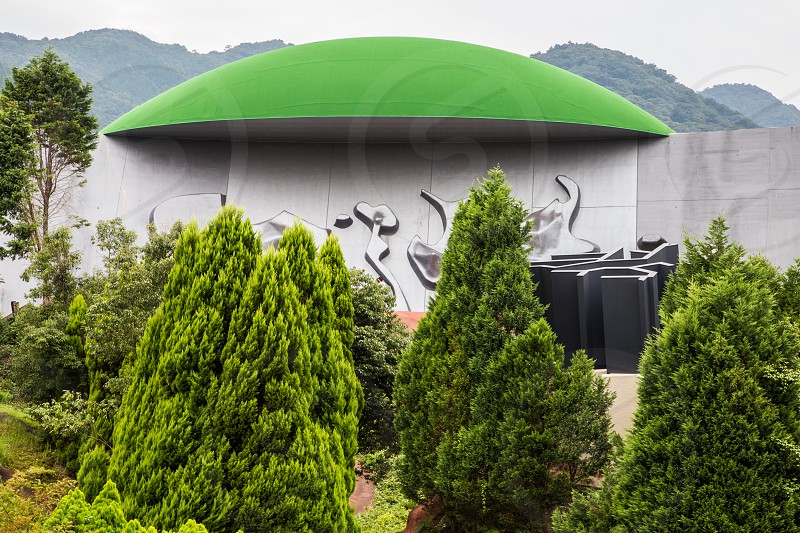 "The Site of Reversible Destiny is an ""experience park"" where you will encounter the unexpected. The park was designed by artists Shusaku Arakawa and Madeline Gins and is made up of steep hills pitch dark rooms deep holes with trees in them. The Insect Mountain Range is a tall pile of rocks to show us that humans don't have to be subjugated to the natural world and humans can create alternative nature.  Then there is Critical Resemblance House is part house part maze. The roof is made in likeness of Gifu Prefecture and scattered about are desks ovens refrigerators toilets beds jutting out of walls and sticking out of the ceiling.  Exactitude Ridge is a bridge sticking out of the ground that stops and goes nowhere.  You have to crawl inside where there are holes in the wall. Destiny House is on top of a giant map of Japan and represents ruins of an ancient building. Kinesthetic Pass resides in the area that represents Kyushu with furniture slightly more useable in part because they're not halfway through a wall or ceiling.  Everything here feels a bit off because of all the angles but certain to adjust your sensory perception if not your destiny.  photo"