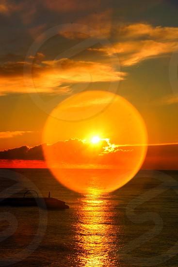 Barcelona Spain sunset sun flare water oceanorange photo