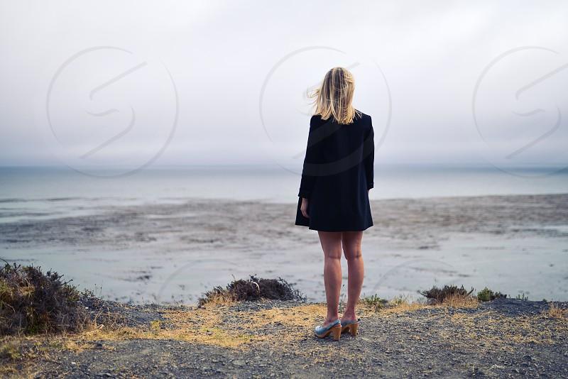 woman dressed ocean contemplation alone sad photo