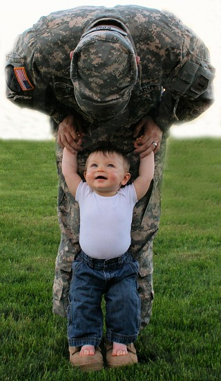 soldier holding boy photo