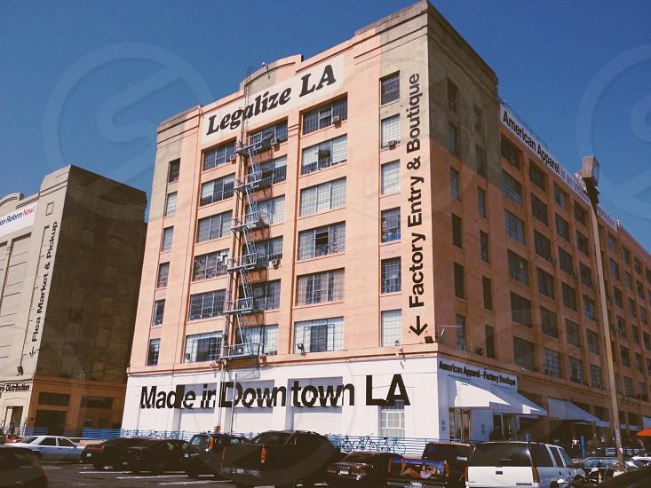 legalize LA signage on brown brick building photo