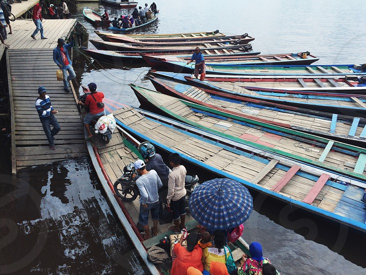 traditional ferry boat boat human harbour street photography photo